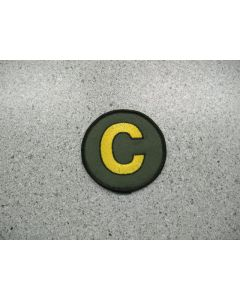 """2958 188C - The Golden """"C"""" Patch on Military Green"""